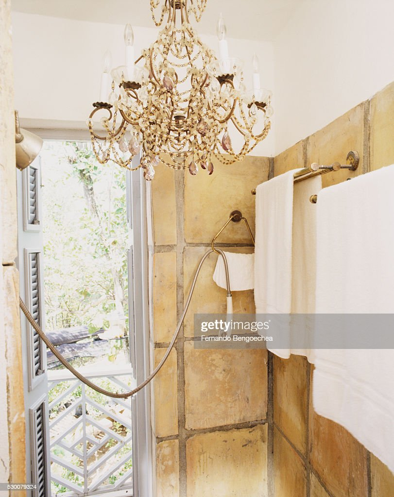Chandelier In Stone Shower Stall With Open Shutters Stock Photo ...