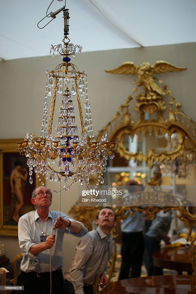 A chandelier is hung in the Mayfair Gallery ahead of the Olympia 'International Fine Art and Antiques Fair' at Olympia Exhibition Centre on June 5, 2013 in London, England. The 41st Olympia Arts and Antiques fair hosts 180 dealers selling items of 20th century design, ceramics, carpets, art deco, 18th and 19th century English furniture, modern British art and tribal art amongst other things. It will open to the public tomorrow until 16 June, 2013.