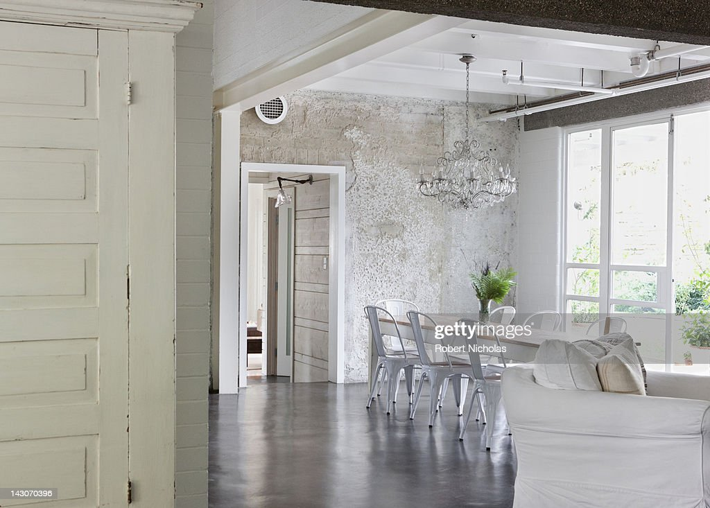 Chandelier, table and chairs in modern dining room : Stock Photo