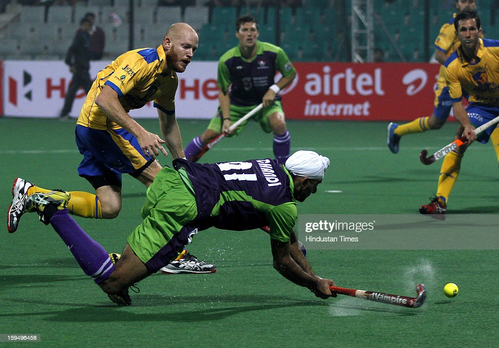 Chandi Gurvinder of Delhi Waveriders plays a shot during the first match of Hockey India League against Punjab Warriors at Major Dhyan Chand Stadium on January 14, 2013 in New Delhi, India. Hockey India League is a professional league for field hockey competition comprising five franchisee-based teams consisting of players from India and around the world. The entire event takes place on home and away basis culminating into multi header playoffs.