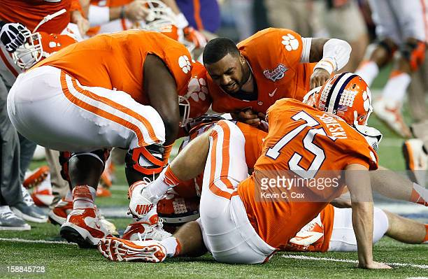 Chandler Catanzaro and Tajh Boyd of the Clemson Tigers react after kicking the gamewinning field goal against the LSU Tigers during the 2012...