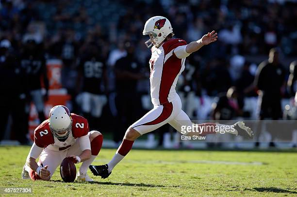 Chandler Catanzaro of the Arizona Cardinals kicks a field goal against the Oakland Raiders at Oco Coliseum on October 19 2014 in Oakland California