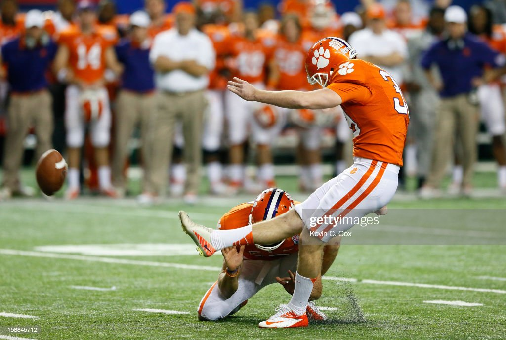Chandler Catanzaro #39 of the Clemson Tigers kicks the game-winning field goal against the LSU Tigers during the 2012 Chick-fil-A Bowl at Georgia Dome on December 31, 2012 in Atlanta, Georgia.