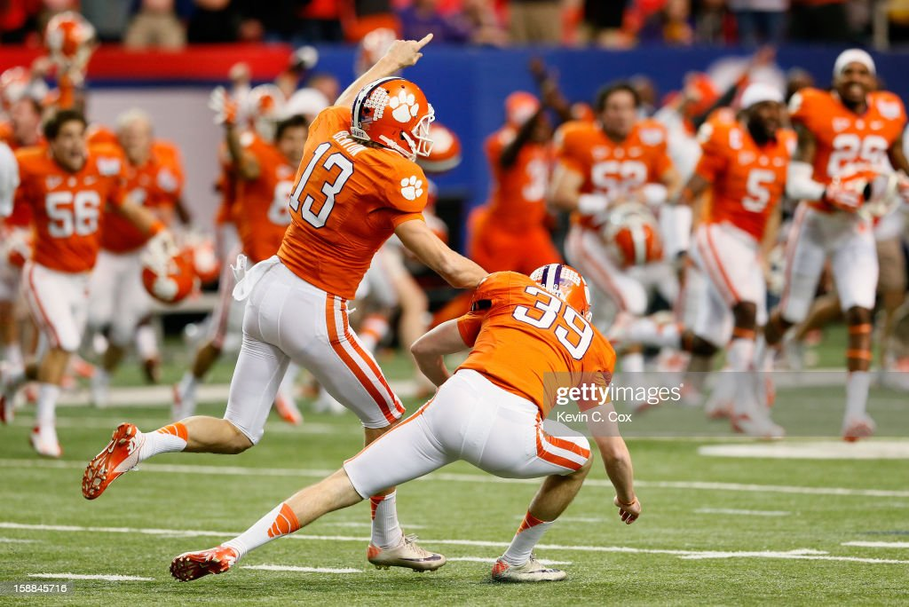 Chandler Catanzaro #39 of the Clemson Tigers reacts with Spencer Benton #13 after kicking the game-winning field goal against the LSU Tigers during the 2012 Chick-fil-A Bowl at Georgia Dome on December 31, 2012 in Atlanta, Georgia.