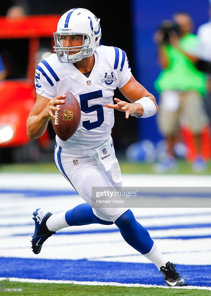 Chandler Hornish #5 of the Indianapolis Colts scrambles out of the pocket to pass against the Buffalo Bills at Lucas Oil Stadium on August 11, 2013 in Indianapolis, Indiana.