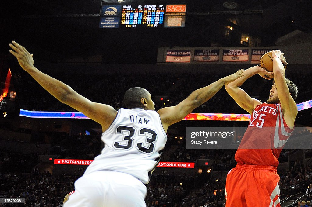 Chandler Parson #25 of the Houston Rockets shoots over Boris Diaw #33 of the San Antonio Spurs at AT&T Center on December 28, 2012 in San Antonio, Texas. San Antonio won the game 122-116.