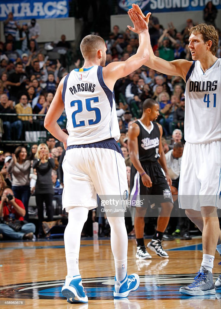Chandler Parsons #25 and Dirk Nowitzki #41 of the Dallas Mavericks slap hands during the game against the Sacramento Kings on November 11, 2014 at the American Airlines Center in Dallas, Texas.