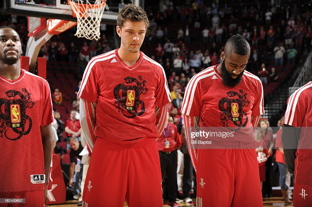 <a gi-track='captionPersonalityLinkClicked' href=/galleries/search?phrase=Chandler+Parsons&family=editorial&specificpeople=4249869 ng-click='$event.stopPropagation()'>Chandler Parsons</a> #25 and <a gi-track='captionPersonalityLinkClicked' href=/galleries/search?phrase=James+Harden&family=editorial&specificpeople=4215938 ng-click='$event.stopPropagation()'>James Harden</a> #13 of the Houston Rockets listen to the national anthem against the Portland Trail Blazers on February 8, 2013 at the Toyota Center in Houston, Texas.