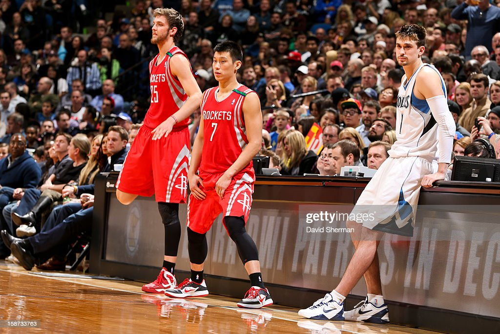 Chandler Parsons #25 and Jeremy Lin #7 of the Houston Rockets, and Alexey Shved #1 of the Minnesota Timberwolves, wait to check back into their game on December 26, 2012 at Target Center in Minneapolis, Minnesota.