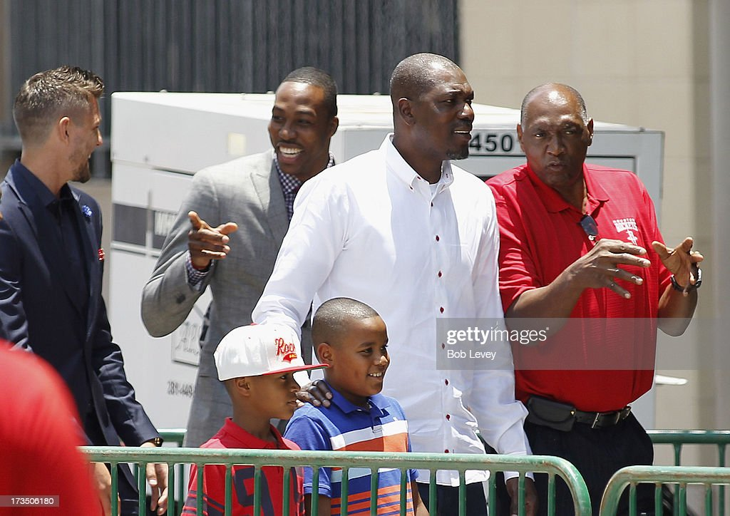 Chandler Parsons Dwight Howard former Houston Rocket players Hakeem Olajuwon and Elvin Hayes attend a street rally after Dwight Howard was officially...