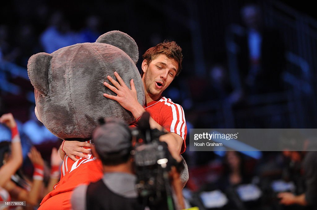 Chandler Parsons #25 of Team Shaq hugs Houston Rockets mascot Clutch before the 2013 BBVA Rising Stars Challenge on February 15, 2013 at Toyota Center in Houston, Texas.
