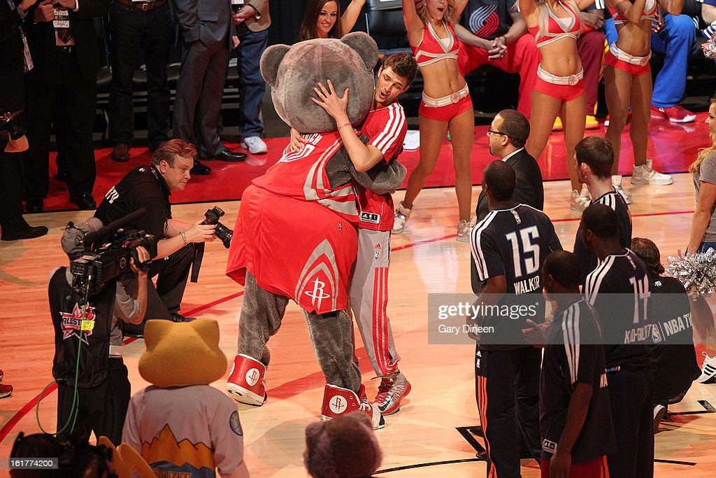 Chandler Parsons #25 of Team Shaq is greeted by mascot Clutch of the Houston Rockets during player introductions prior to the 2013 BBVA Rising Stars Challenge on February 15, 2013 at the Toyota Center in Houston, Texas.