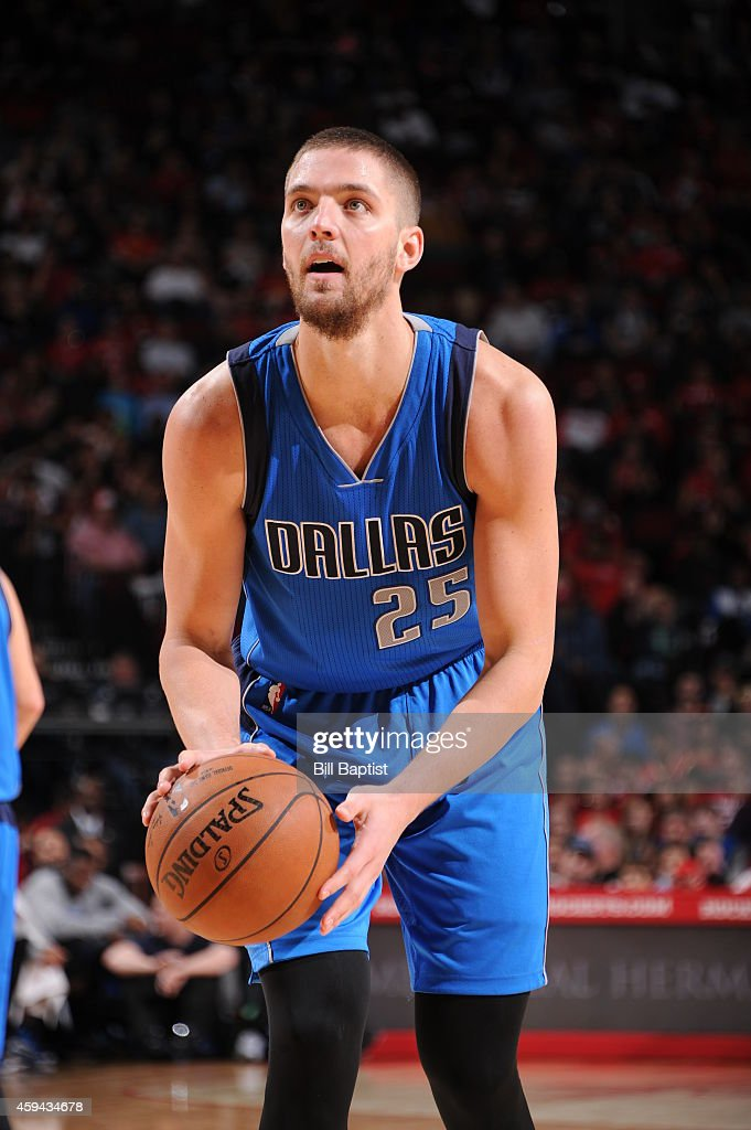 Chandler Parsons #25 of the Dallas Mavericks shoots a free throw against the Houston Rockets during the game on November 22, 2014 at the Toyota Center in Houston, Texas.