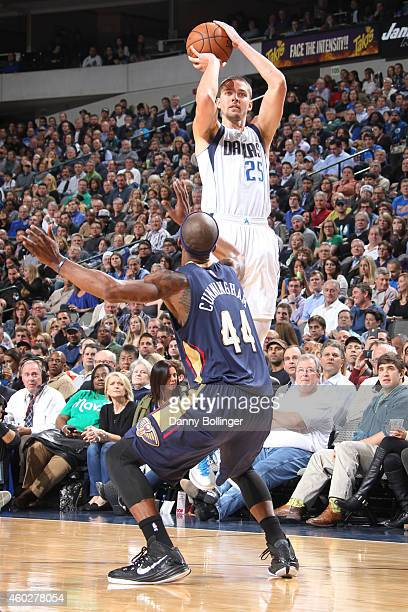 Chandler Parsons of the Dallas Mavericks shoots a jumper against Dante Cunningham of the New Orleans Pelicans on December 10 2014 at the American...
