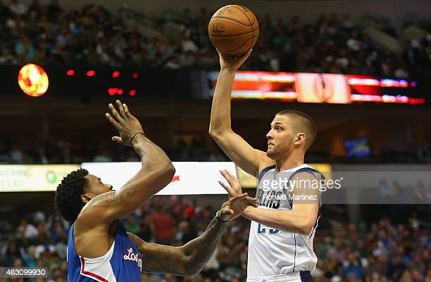 Chandler Parsons of the Dallas Mavericks takes a shot against DeAndre Jordan of the Los Angeles Clippers at American Airlines Center on February 9...
