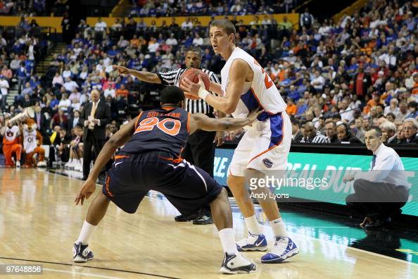 Chandler Parsons of the Florida Gators looks to pass the ball against Frankie Sullivan of the Auburn Tigers during the first round of the SEC Men's...