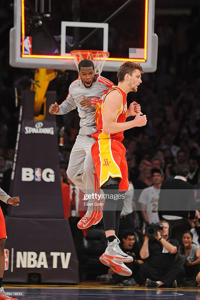 <a gi-track='captionPersonalityLinkClicked' href=/galleries/search?phrase=Chandler+Parsons&family=editorial&specificpeople=4249869 ng-click='$event.stopPropagation()'>Chandler Parsons</a> #25 of the Houston Rockets celebrates a play against the Los Angeles Lakers at Staples Center on April 17, 2013 in Los Angeles, California.