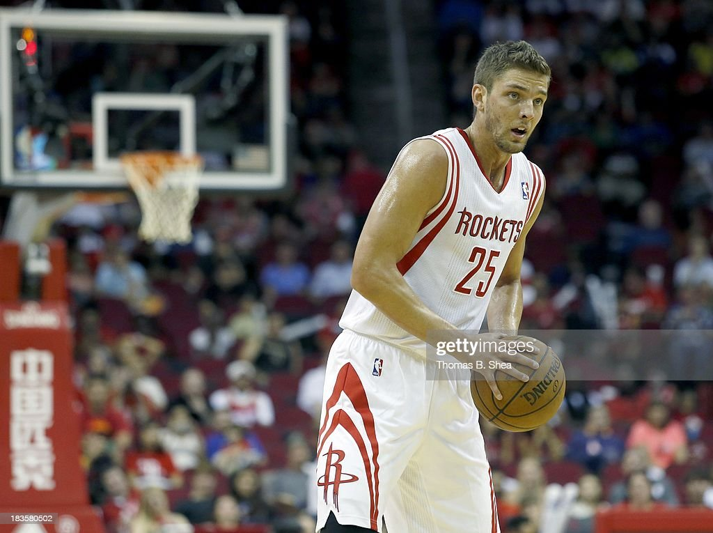 Chandler Parsons #25 of the Houston Rockets dribbles against the New Orleans Pelicans in a preseason NBA game on October 5, 2013 at Toyota Center in Houston, Texas. The Pelicans won 116 to 115.
