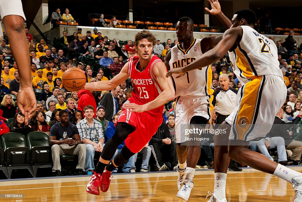 Chandler Parsons #25 of the Houston Rockets drives against Lance Stephenson #1 and Ian Mahinmi #28 of the Indiana Pacers on January 18, 2013 at Bankers Life Fieldhouse in Indianapolis, Indiana.