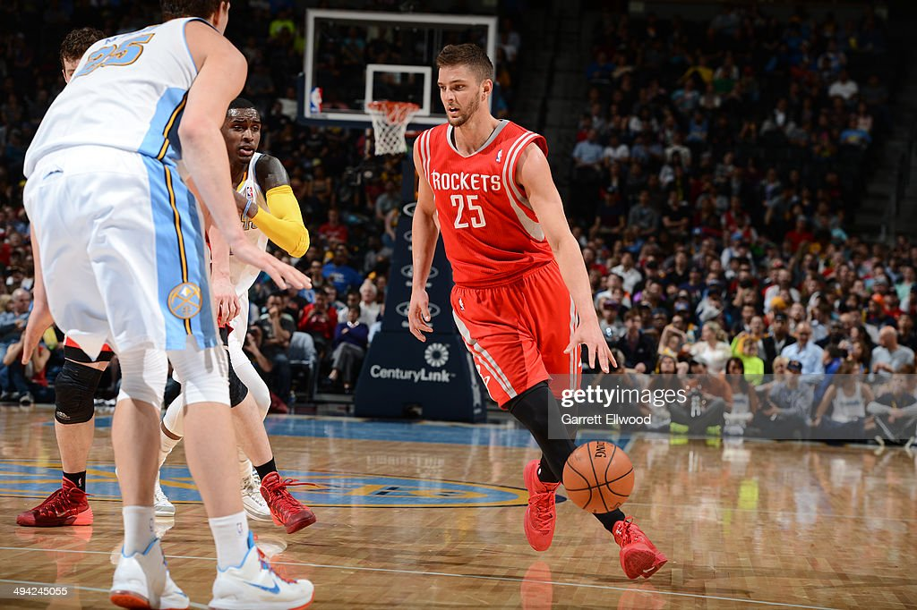 Chandler Parsons #25 of the Houston Rockets drives against the Denver Nuggets on April 9, 2014 at the Pepsi Center in Denver, Colorado.