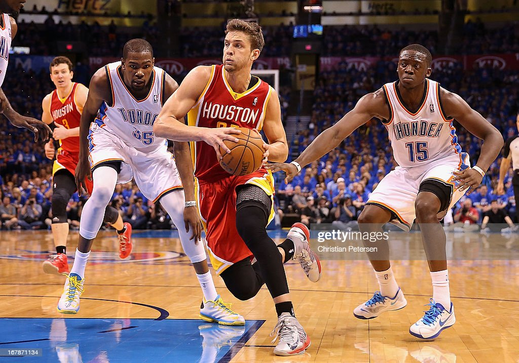 Chandler Parsons #25 of the Houston Rockets drives the ball past Kevin Durant #35 and Reggie Jackson #15 of the Oklahoma City Thunder during Game Five of the Western Conference Quarterfinals of the 2013 NBA Playoffs at Chesapeake Energy Arena on May 1, 2013 in Oklahoma City, Oklahoma. The Rockets defeated the Thunder 107-100.