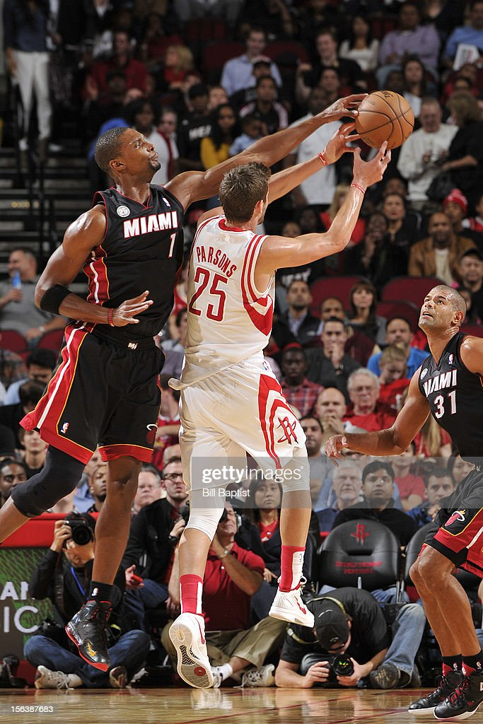 Chandler Parsons #25 of the Houston Rockets drives to the basket against Chris Bosh #1 of the Miami Heat on November 12, 2012 at the Toyota Center in Houston, Texas.