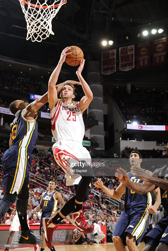 <a gi-track='captionPersonalityLinkClicked' href=/galleries/search?phrase=Chandler+Parsons&family=editorial&specificpeople=4249869 ng-click='$event.stopPropagation()'>Chandler Parsons</a> #25 of the Houston Rockets drives to the basket against the Utah Jazz on December 1, 2012 at the Toyota Center in Houston, Texas.
