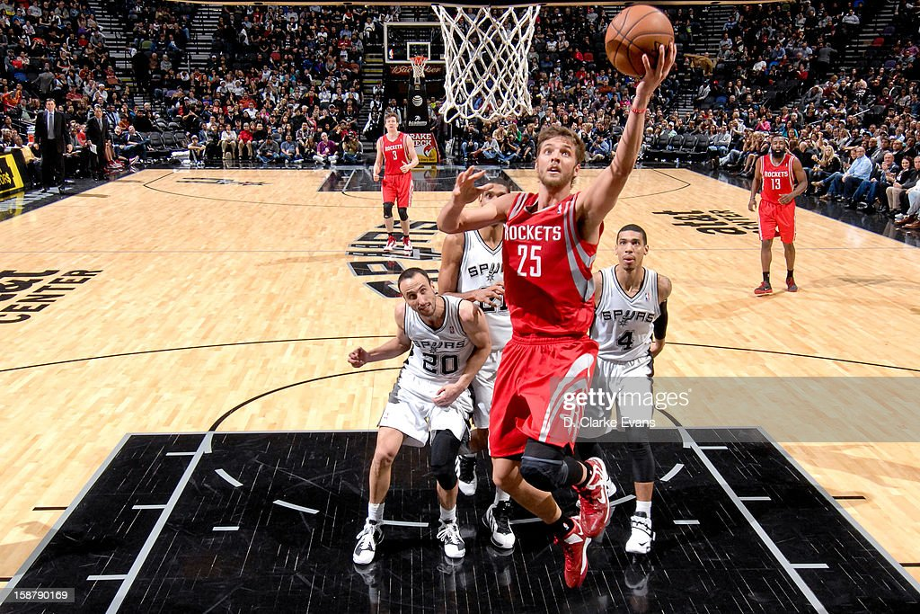 Chandler Parsons #25 of the Houston Rockets drives to the basket against the San Antonio Spurs on December 28, 2012 at the AT&T Center in San Antonio, Texas.