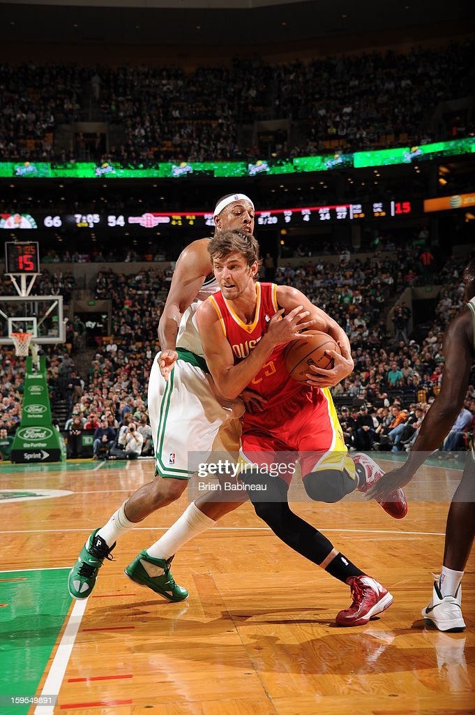 Chandler Parsons #25 of the Houston Rockets drives to the basket against Paul Pierce #34 of the Boston Celtics on January 11, 2013 at the TD Garden in Boston, Massachusetts.