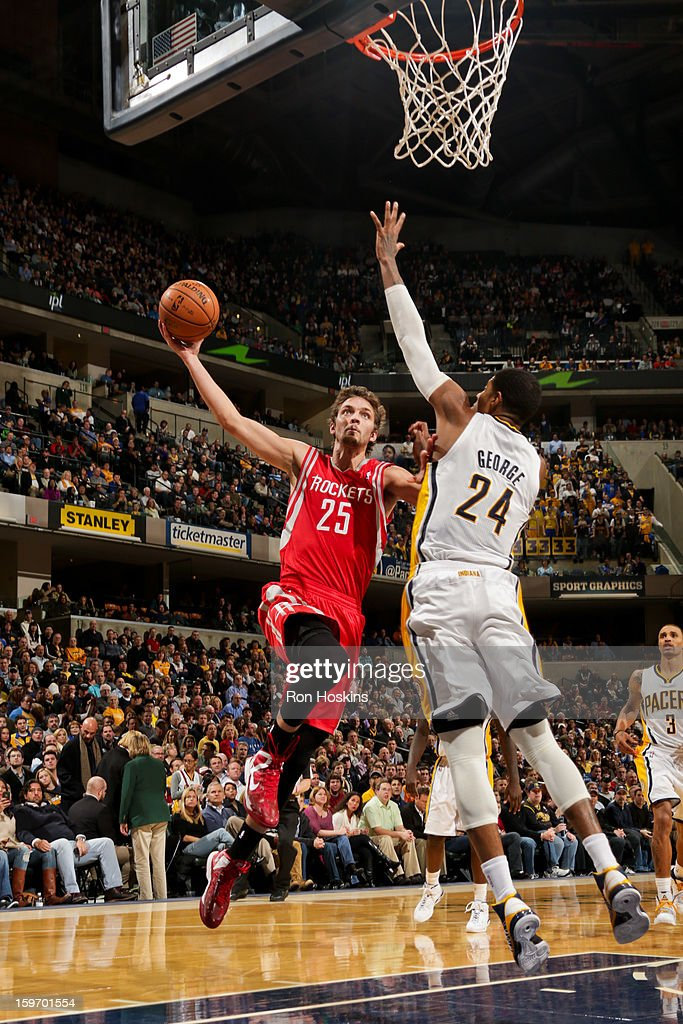 Chandler Parsons #25 of the Houston Rockets drives to the basket against Paul George #24 of the Indiana Pacers of the Indiana Pacers of the Houston Rockets on January 18, 2013 at Bankers Life Fieldhouse in Indianapolis, Indiana.