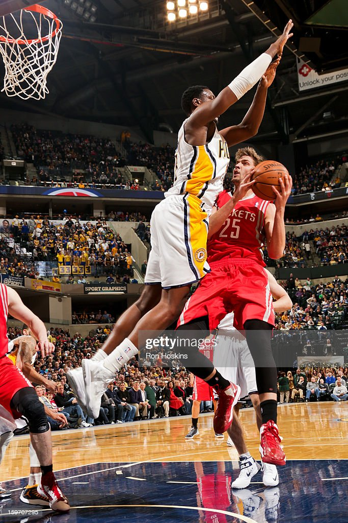Chandler Parsons #25 of the Houston Rockets drives to the basket against Ian Mahinmi #28 of the Indiana Pacers on January 18, 2013 at Bankers Life Fieldhouse in Indianapolis, Indiana.