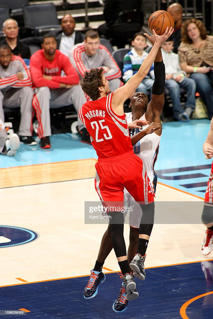Chandler Parsons #25 of the Houston Rockets drives to the basket against Bismack Biyombo #0 of the Charlotte Bobcats at the Time Warner Cable Arena on January 21, 2013 in Charlotte, North Carolina.