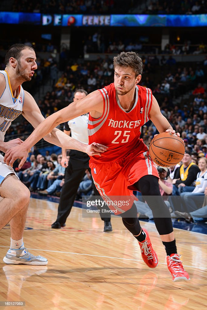 Chandler Parsons #25 of the Houston Rockets drives to the basket against Kosta Koufos #41 of the Denver Nuggets on January 30, 2013 at the Pepsi Center in Denver, Colorado.
