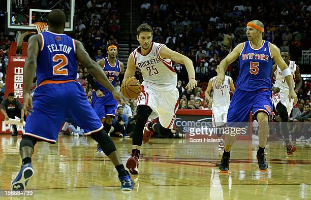 Chandler Parsons of the Houston Rockets drives upcourt against Jason Kidd and Raymond Felton of the New York Knicks at the Toyota Center on November...