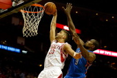 Chandler Parsons of the Houston Rockets dunks the ball against Serge Ibaka of the Oklahoma City Thunder during a game at the Toyota Center on April 4...