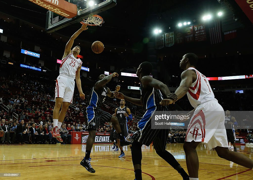 <a gi-track='captionPersonalityLinkClicked' href=/galleries/search?phrase=Chandler+Parsons&family=editorial&specificpeople=4249869 ng-click='$event.stopPropagation()'>Chandler Parsons</a> #25 of the Houston Rockets dunks the ball against <a gi-track='captionPersonalityLinkClicked' href=/galleries/search?phrase=Victor+Oladipo&family=editorial&specificpeople=6681560 ng-click='$event.stopPropagation()'>Victor Oladipo</a> #5 of the Orlando Magic at Toyota Center on December 8, 2013 in Houston, Texas.