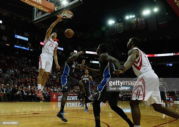 Chandler Parsons of the Houston Rockets dunks the ball against Victor Oladipo of the Orlando Magic at Toyota Center on December 8 2013 in Houston...
