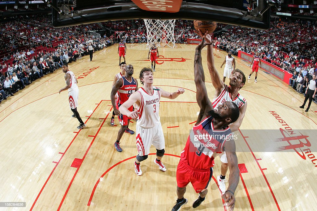 Chandler Parsons #25 of the Houston Rockets goes up for a rebound against Martell Webster #9 of the Washington Wizards on December 12, 2012 at the Toyota Center in Houston, Texas.