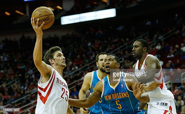 Chandler Parsons of the Houston Rockets goes up for a shot over Dominic McGuire of the New Orleans Hornets at Toyota Center on January 2 2013 in...