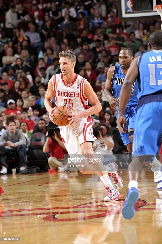 <a gi-track='captionPersonalityLinkClicked' href=/galleries/search?phrase=Chandler+Parsons&family=editorial&specificpeople=4249869 ng-click='$event.stopPropagation()'>Chandler Parsons</a> #25 of the Houston Rockets handles the ball against the Dallas Mavericks on March 3, 2013 at the Toyota Center in Houston, Texas.