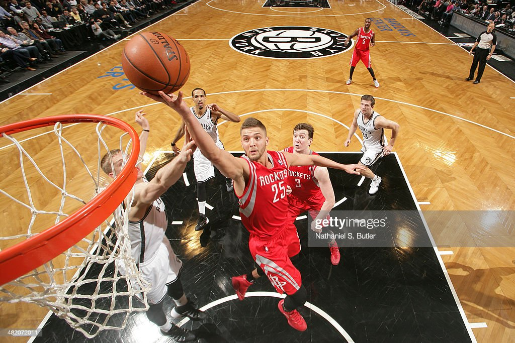<a gi-track='captionPersonalityLinkClicked' href=/galleries/search?phrase=Chandler+Parsons&family=editorial&specificpeople=4249869 ng-click='$event.stopPropagation()'>Chandler Parsons</a> #25 of the Houston Rockets lays the ball in the basket during the game against the Brooklyn Nets at the Barclays Center on April 01, 2014 in the Brooklyn borough of New York City.