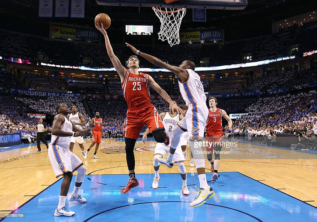 Chandler Parsons #25 of the Houston Rockets lays up a shot past Kevin Durant #35 of the Oklahoma City Thunder during the first half of Game Two of the Western Conference Quarterfinals of the 2013 NBA Playoffs at Chesapeake Energy Arena on April 24, 2013 in Oklahoma City, Oklahoma.