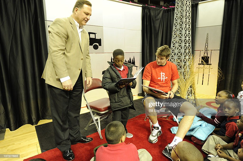 Chandler Parsons #25 of the Houston Rockets reads to children during Read Play Win on January 18, 2012 at the Toyota Center in Houston, Texas.