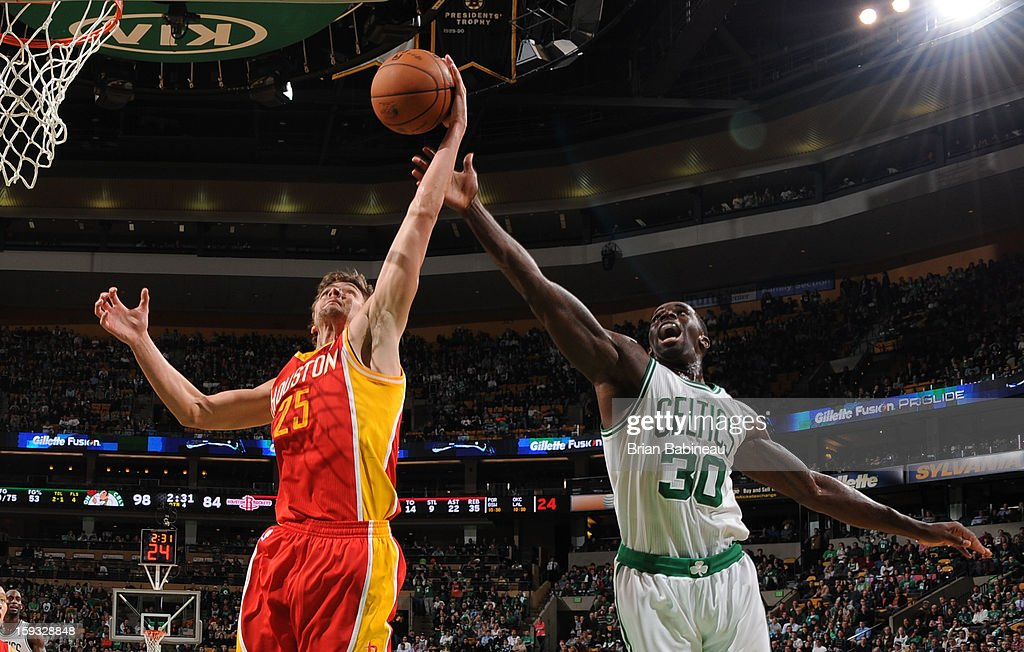 Chandler Parsons #25 of the Houston Rockets rebounds against Brandon Bass #30 of the Boston Celtics on January 11, 2013 at the TD Garden in Boston, Massachusetts.