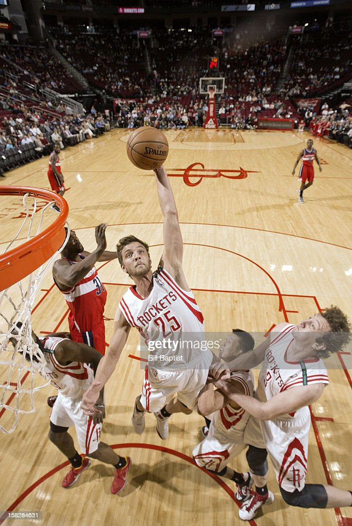 Chandler Parsons #25 of the Houston Rockets rebounds the ball against the Washington Wizards on December 12, 2012 at the Toyota Center in Houston, Texas.
