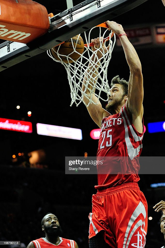 Chandler Parsons #25 of the Houston Rockets scores against the San Antonio Spurs during a game at AT&T Center on December 28, 2012 in San Antonio, Texas. San Antonio won the game 122-116.