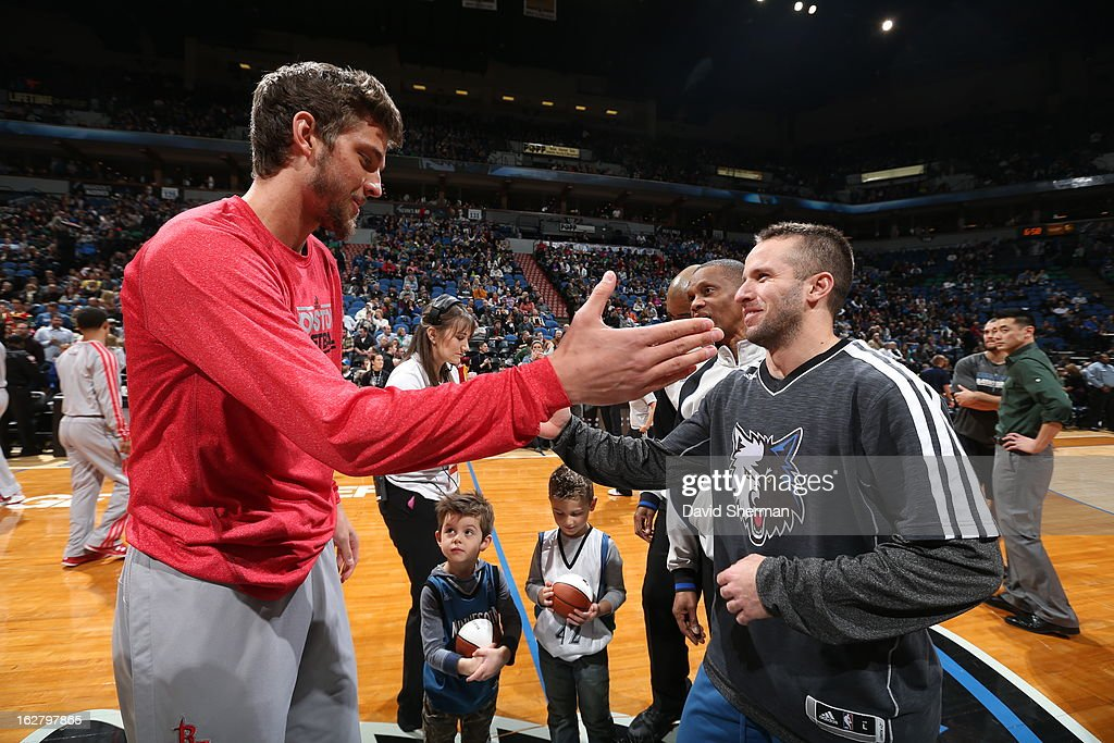Chandler Parsons #25 of the Houston Rockets shakes hands with J.J. Barea #11 of the Minnesota Timberwolves before the game on December 26, 2012 at Target Center in Minneapolis, Minnesota.