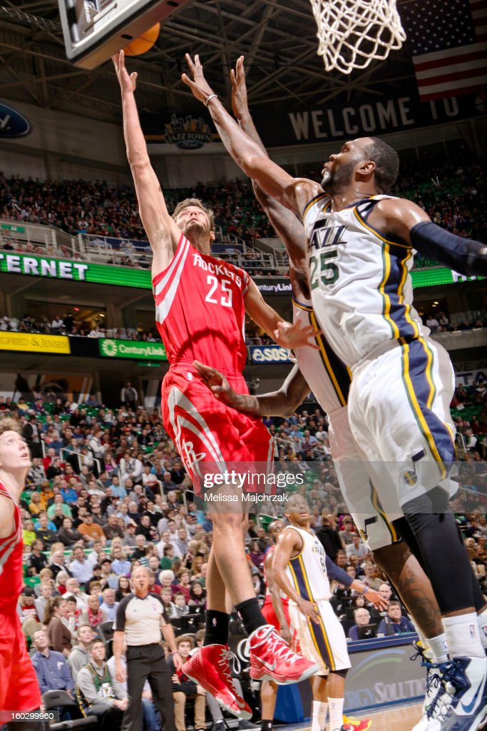 Chandler Parsons #25 of the Houston Rockets shoots a layup against Al Jefferson #25 of the Utah Jazz at Energy Solutions Arena on January 28, 2013 in Salt Lake City, Utah.