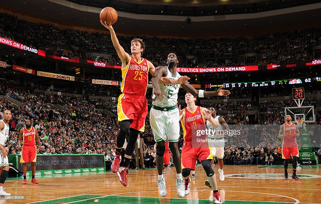 Chandler Parsons #25 of the Houston Rockets shoots a layup against Kevin Garnett #5 of the Boston Celtics on January 11, 2013 at the TD Garden in Boston, Massachusetts.