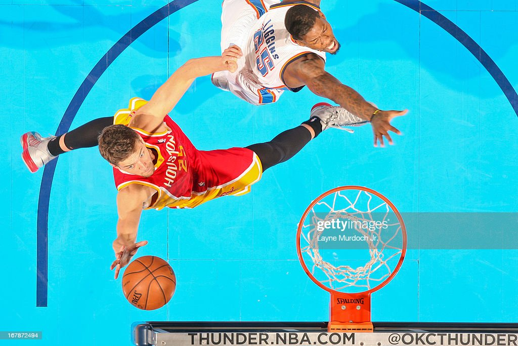 Chandler Parsons #25 of the Houston Rockets shoots a layup against DeAndre Liggins #25 of the Oklahoma City Thunder in Game Five of the Western Conference Quarterfinals during the 2013 NBA Playoffs on May 1, 2013 at the Chesapeake Energy Arena in Oklahoma City, Oklahoma.